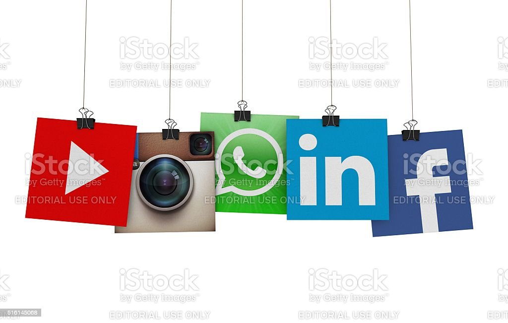 Social media icons hanging on strings stock photo