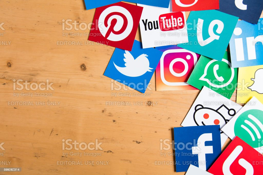 Social media icons on a wooden background stock photo