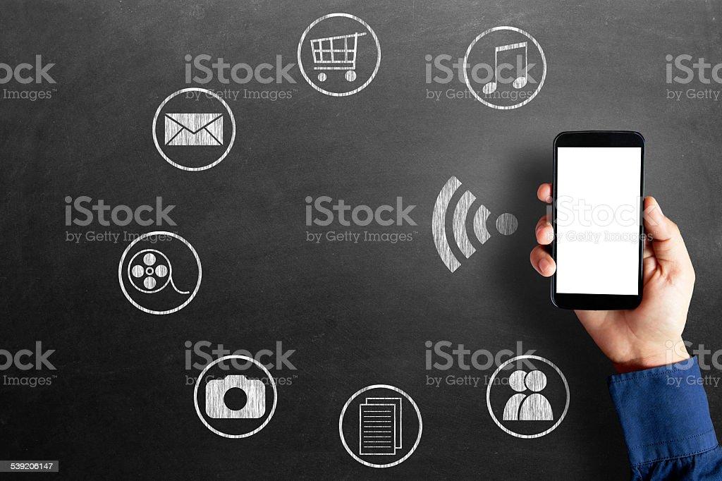 Social media icons on blackboard stock photo