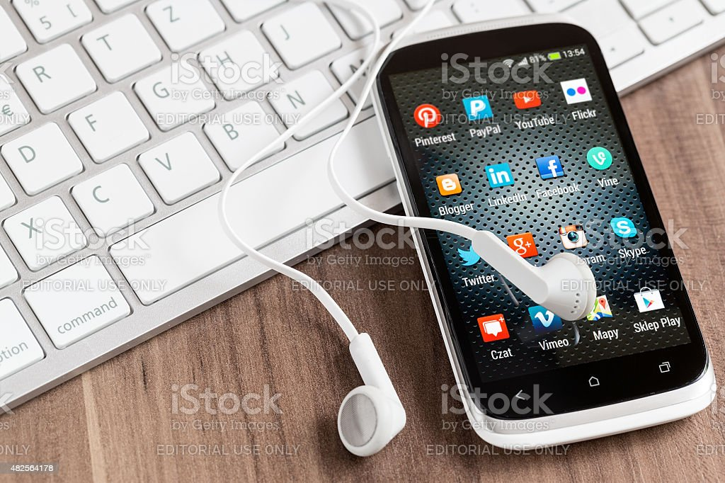 Social media icons on smart phone screen stock photo