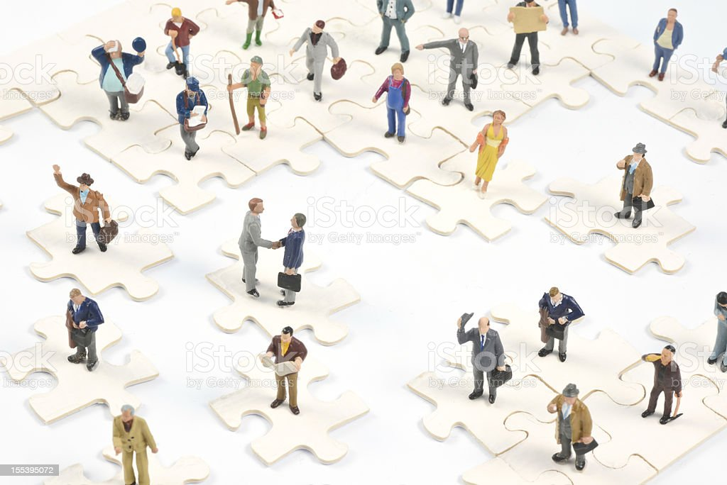 Social Media Little people on puzzle pieces stock photo