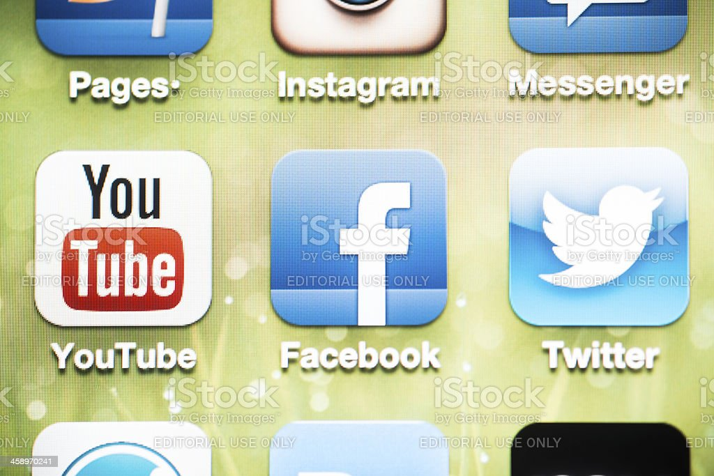 Social Media Logos on iPhone 4 screen royalty-free stock photo