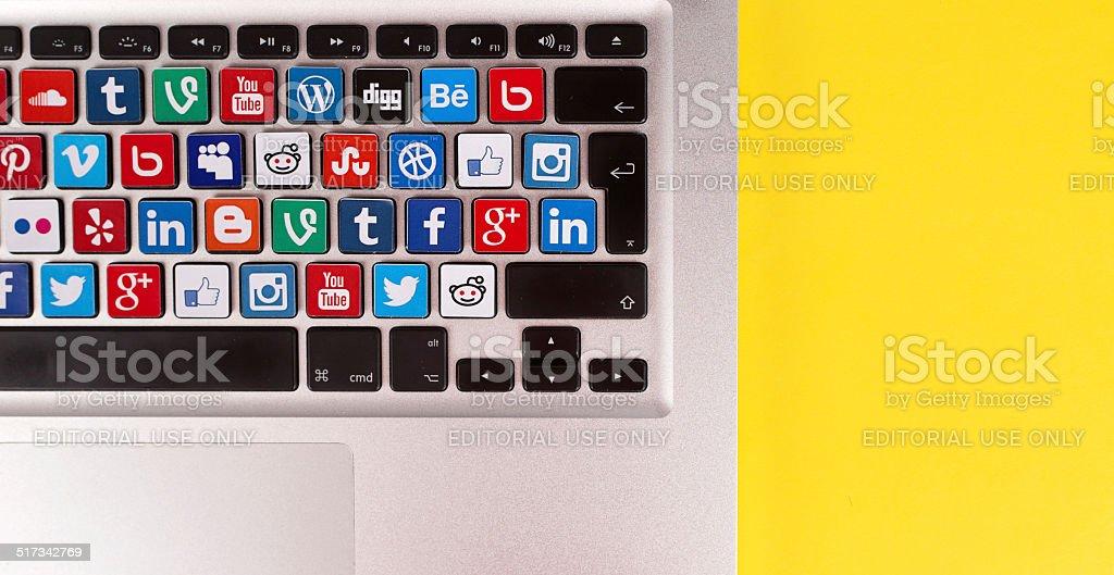 Social Media Logos on Macbook Keyboard stock photo