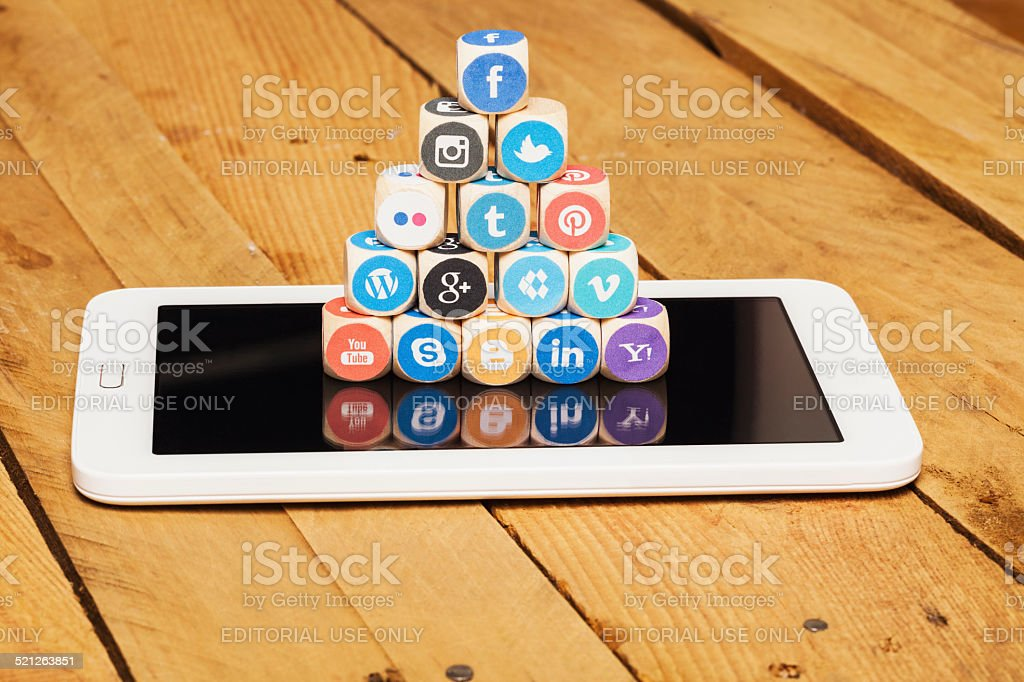 Social media logos on tablet computer stock photo