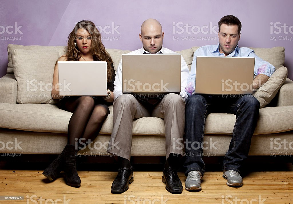 Social Media, men and women networking on sofa royalty-free stock photo