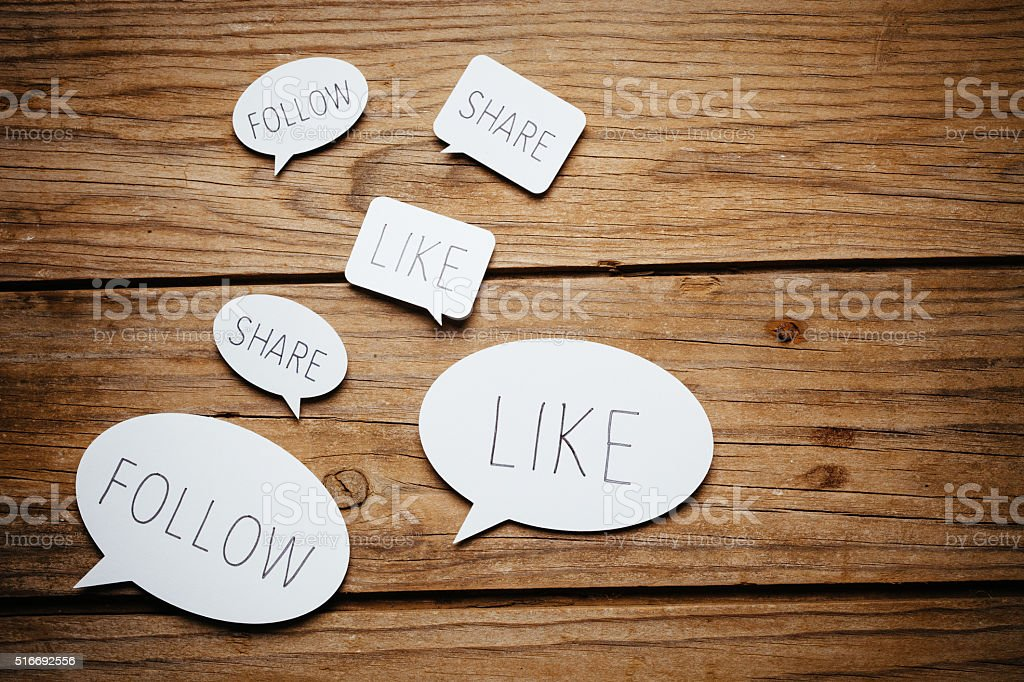 Social media on wooden background. stock photo