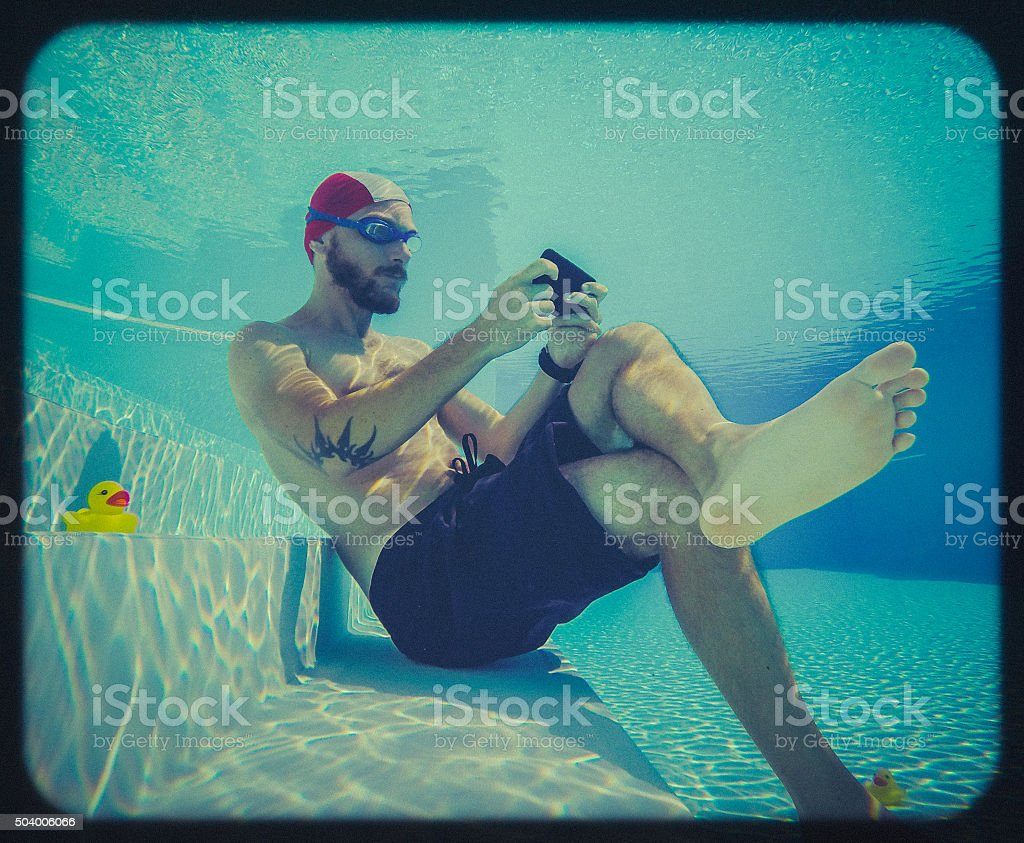 Social networking underwater: toy camera effect stock photo