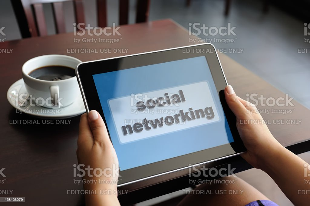 Social networking with iPad royalty-free stock photo