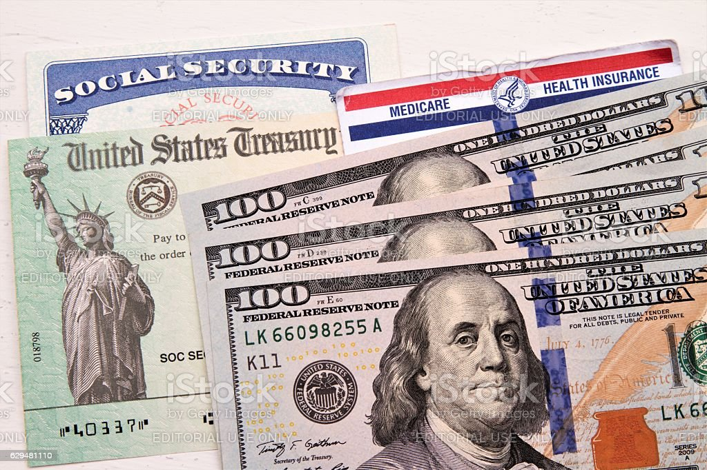 Social Security and Medicare cards, Treasury check, hundred dollar bills stock photo