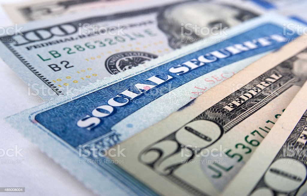 Social security card and American money dollar bills stock photo