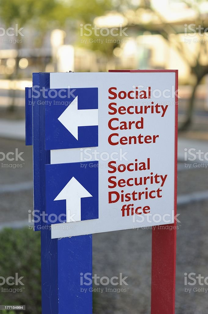 Social security card and office district sign royalty-free stock photo