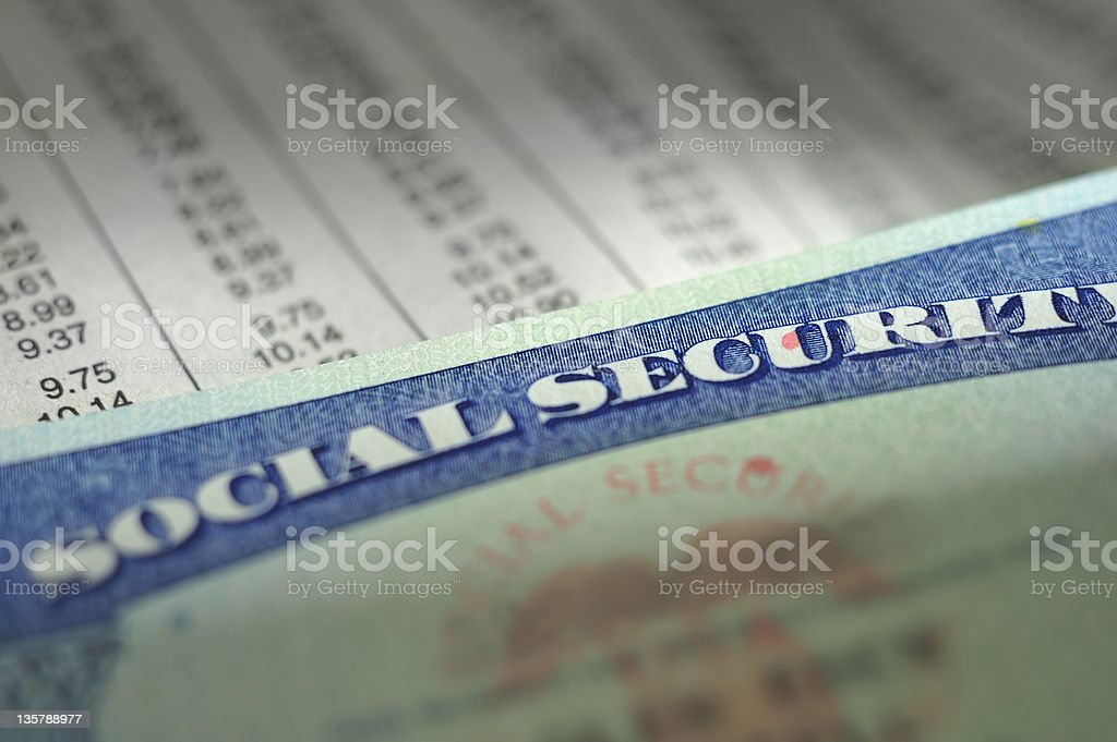 Social Security card on payroll deduction chart royalty-free stock photo
