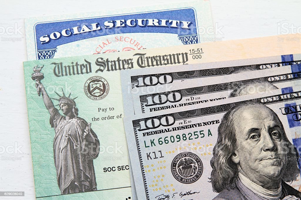 Social Security card, Treasury checks and hundred dollar bills stock photo