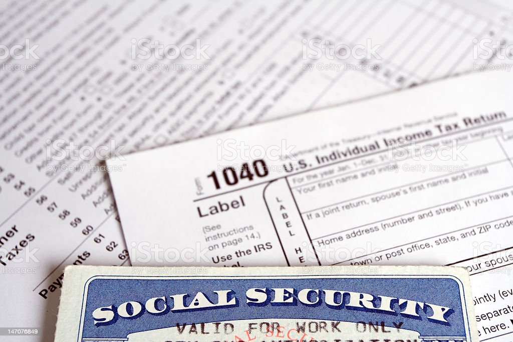 Social Security card with tax forms stock photo