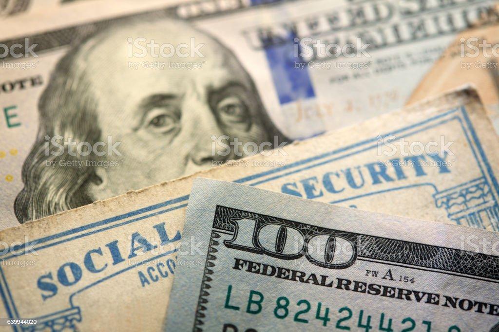 Social Security Cards Between $100 Bills stock photo