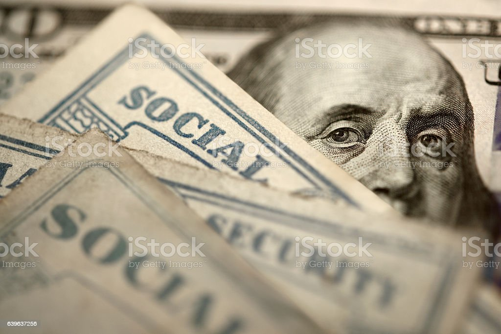 Social Security Cards On Top Of $100 Bill stock photo