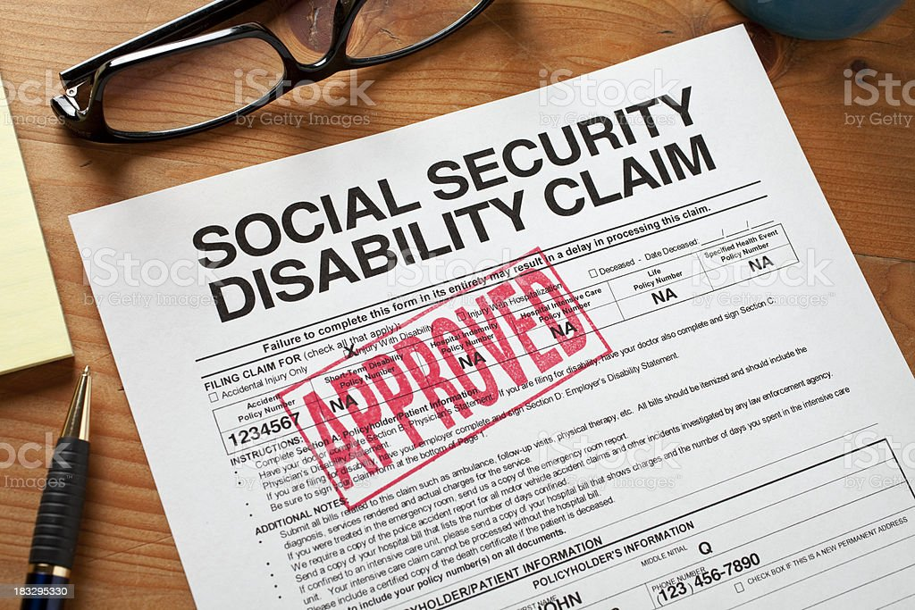 Social Security Disabilty form stamped APPROVED. stock photo