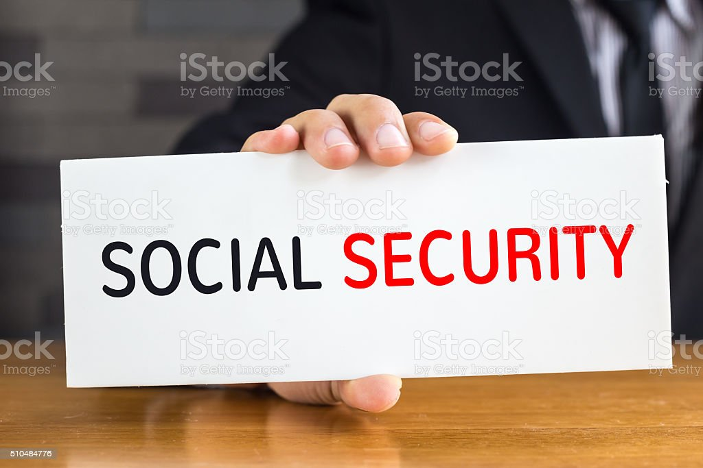 Social security, message on white card and hold by businessman stock photo