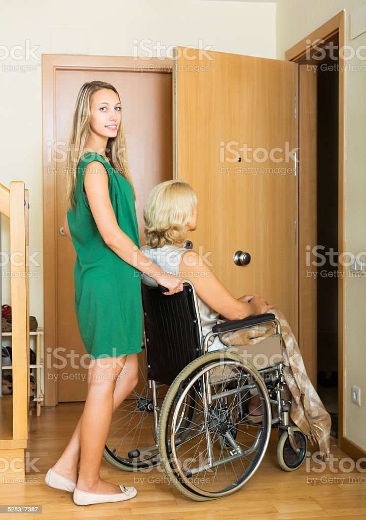 Social worker and disabled woman stock photo