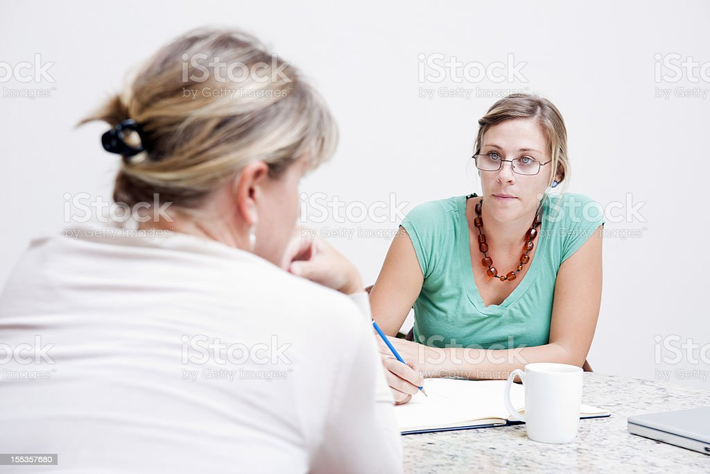 Social worker consulting with a client royalty-free stock photo