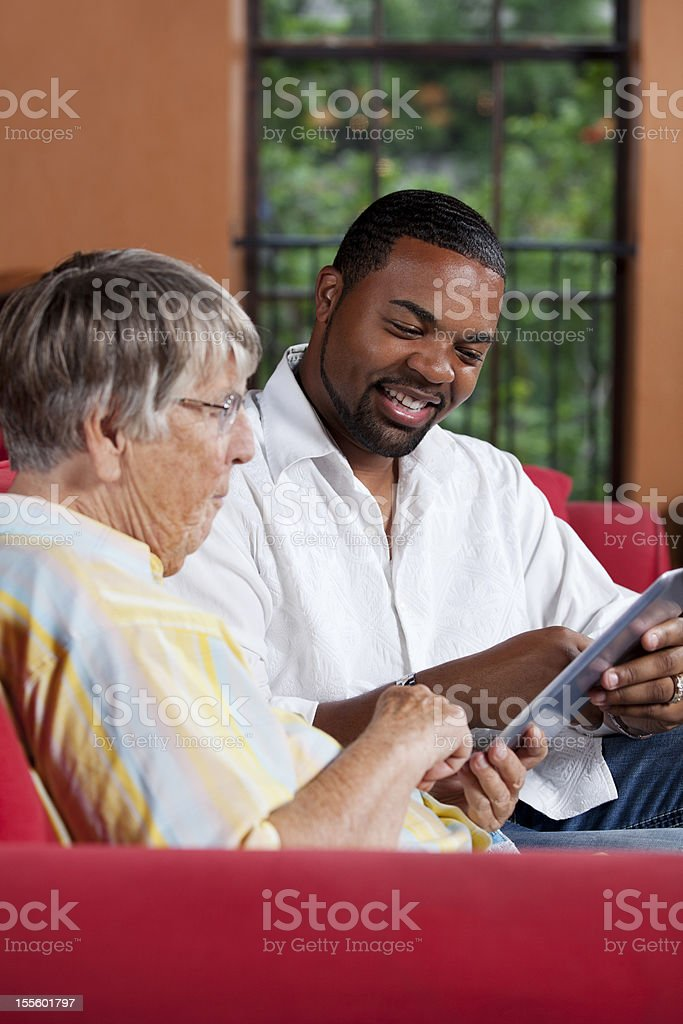 Social worker explaining something to a senior woman royalty-free stock photo