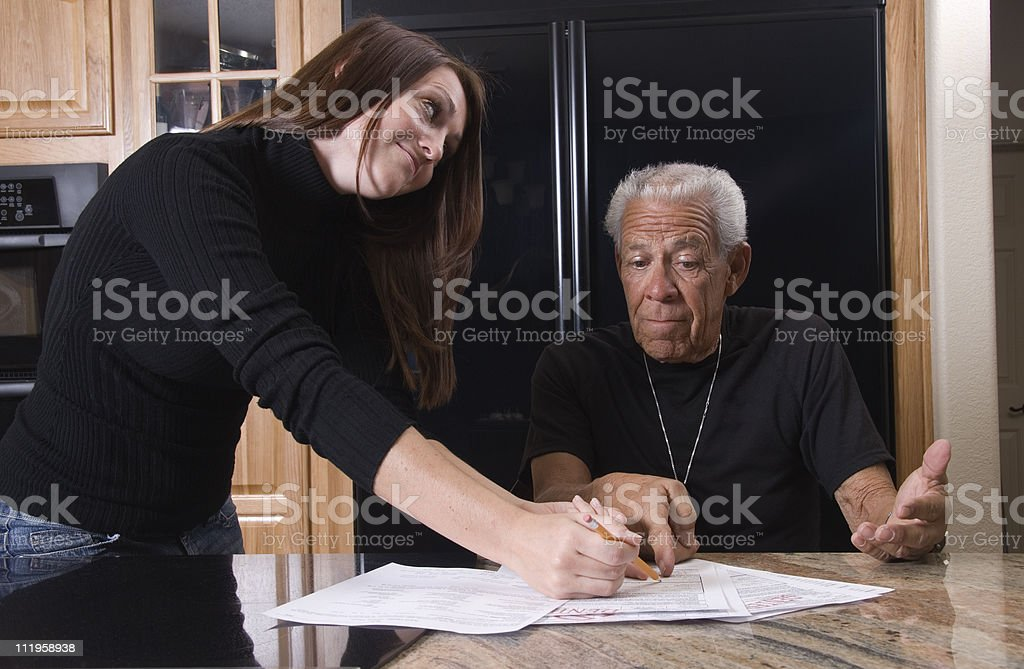 Social worker explains the forms to a senior royalty-free stock photo