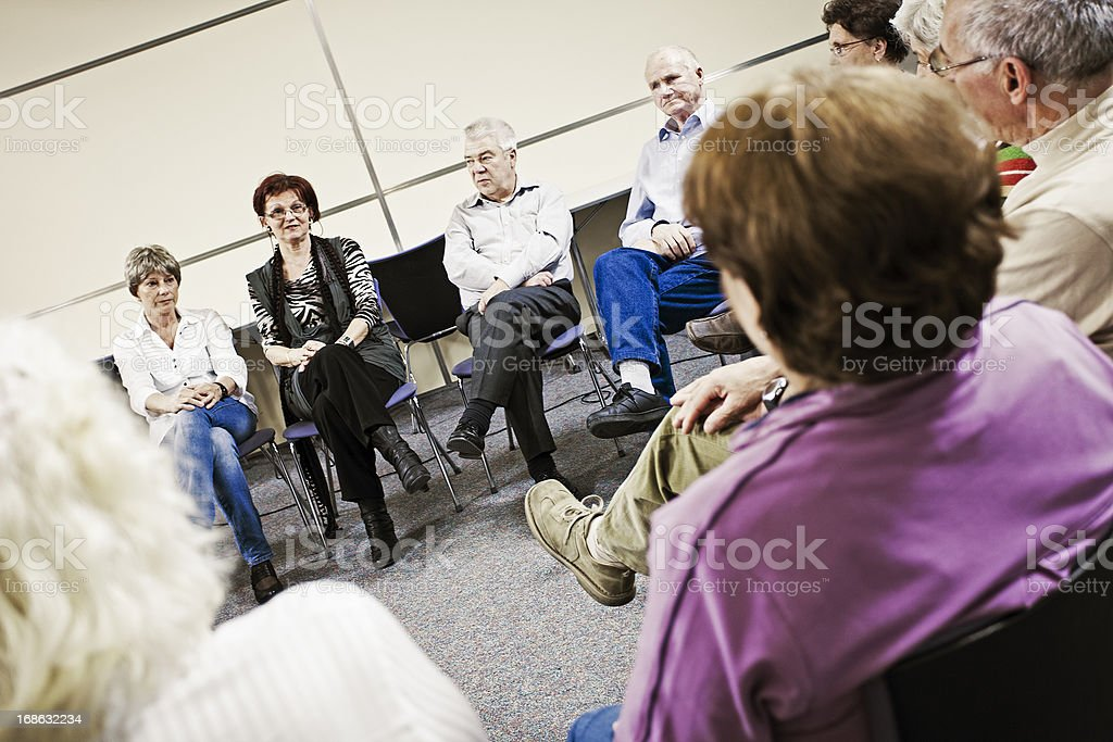Social worker in the community center royalty-free stock photo