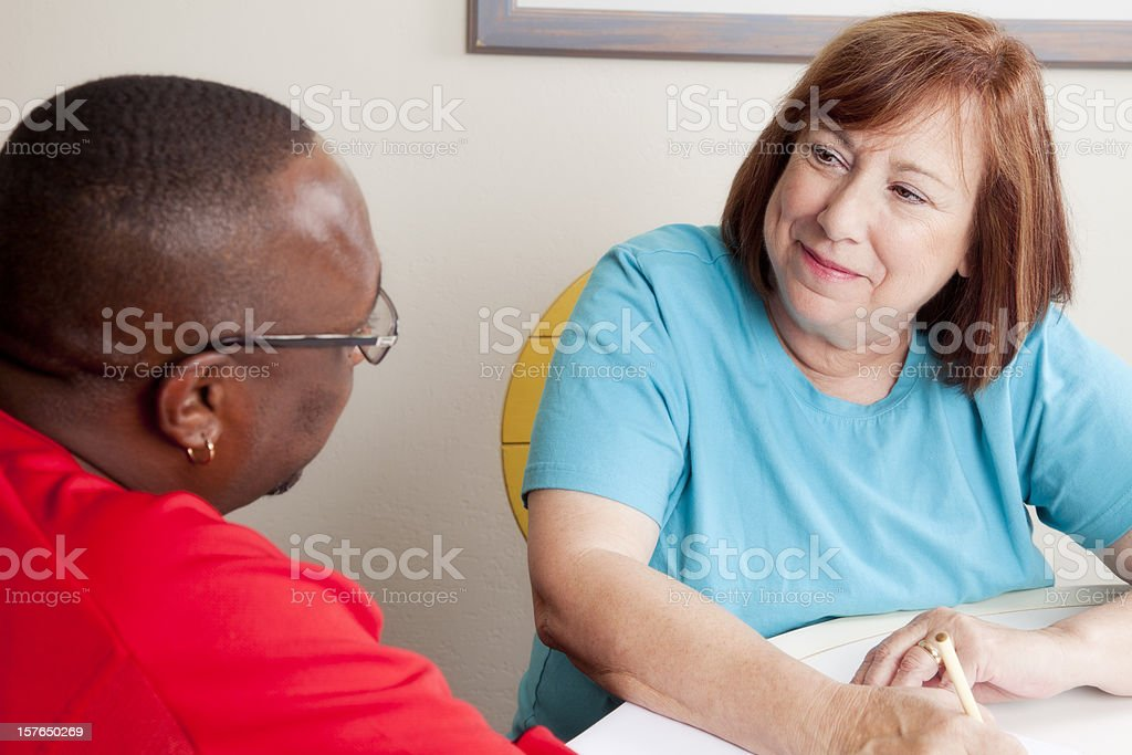 Social worker interviewing african-american man royalty-free stock photo