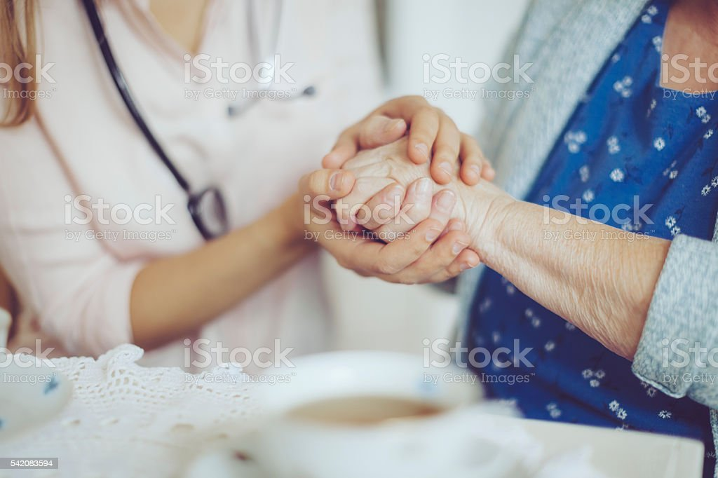 Social worker is visiting a senior woman stock photo