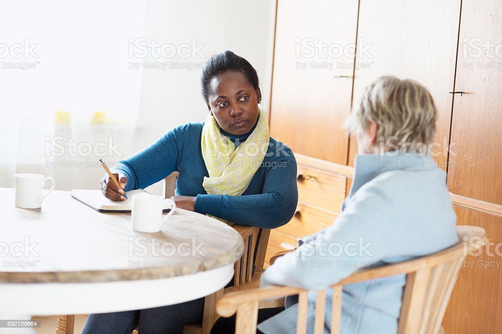 social worker meeting a client stock photo