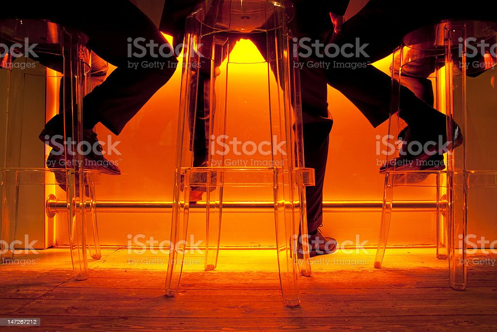 Socialising in a bar after work stock photo