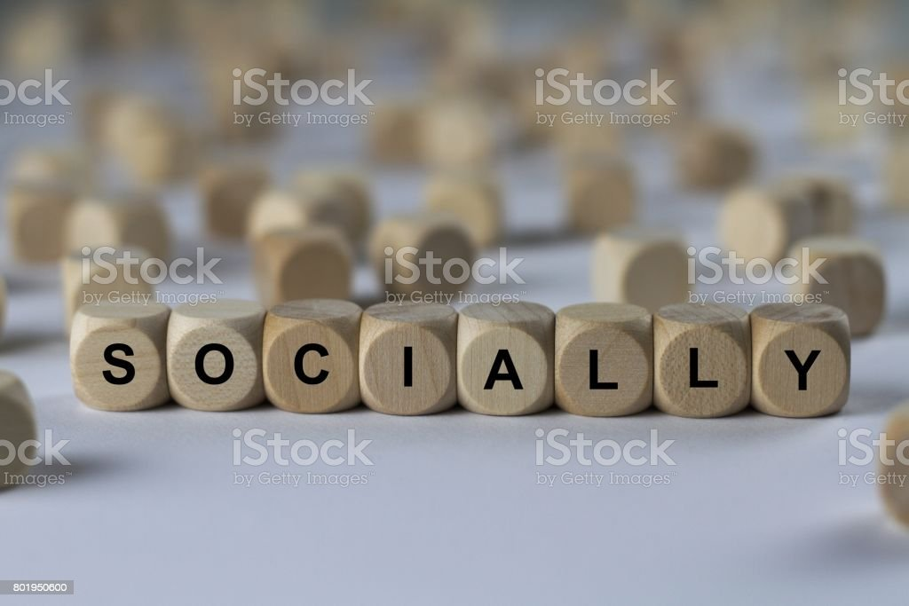 socially - cube with letters, sign with wooden cubes stock photo