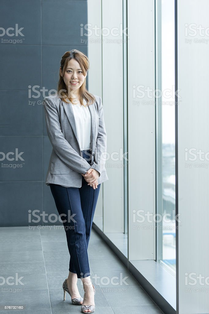 Society women standing in the window (business image) photo libre de droits