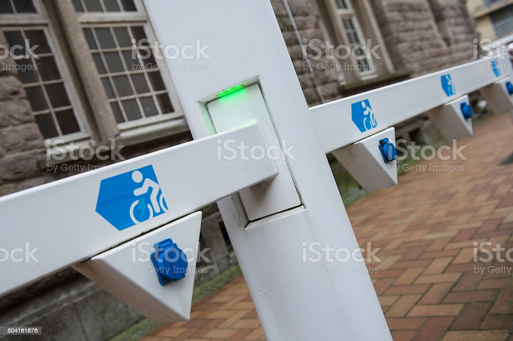 Socket for electrical bike battery charger with green led lights stock photo