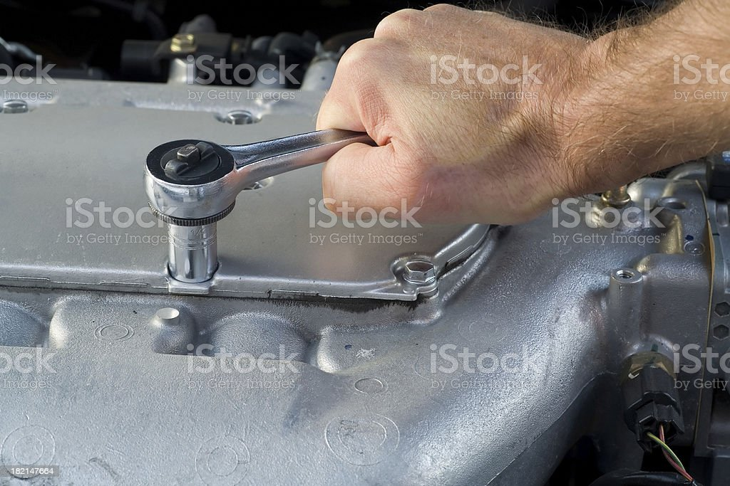 Socket Wrench on Automobile Engine Block royalty-free stock photo
