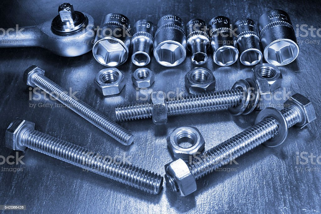 Socket wrench set of stainless steel hex sockets with nuts stock photo