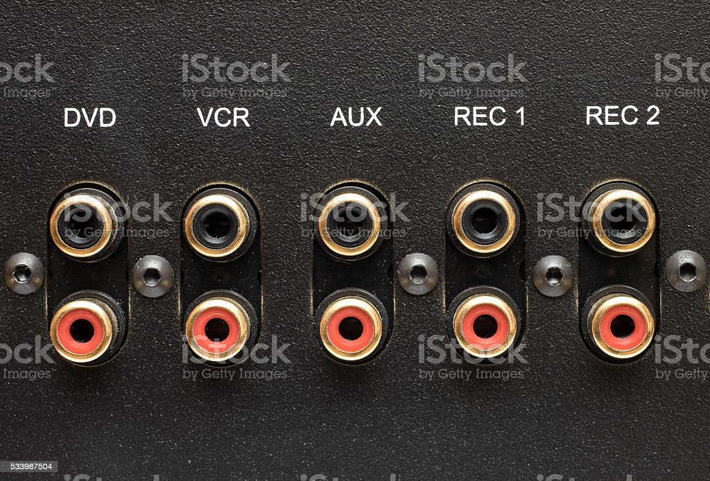 Sockets of various inputs on an black metal panel. stock photo