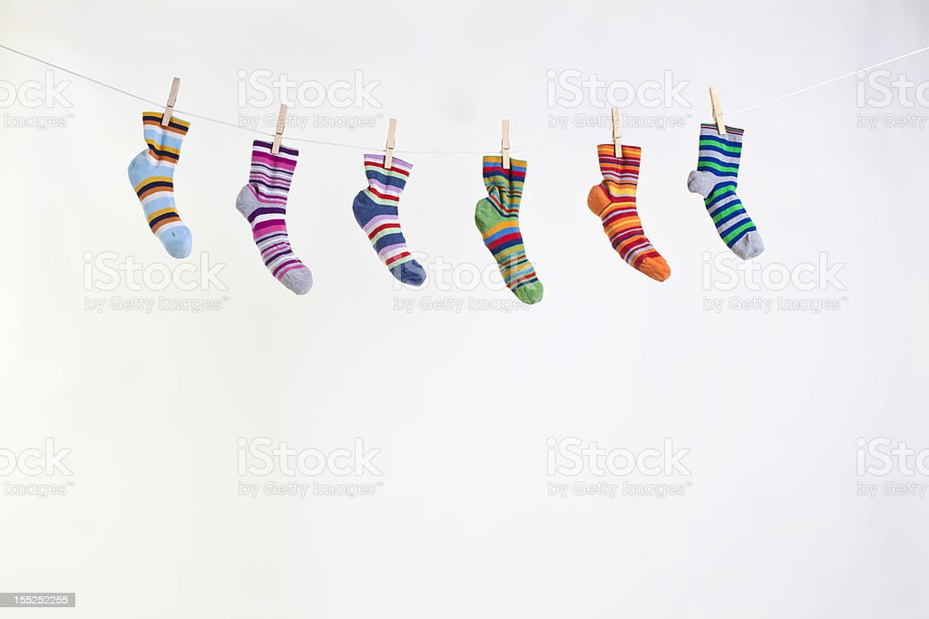 socks on a rope with pegs royalty-free stock photo