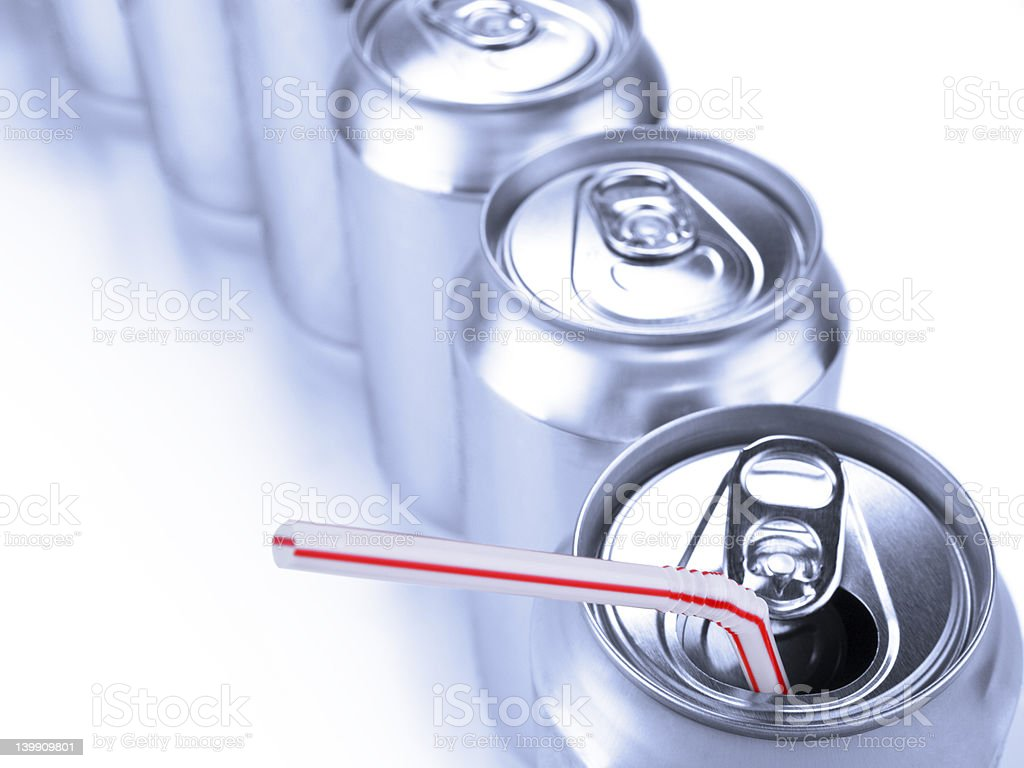 Soda cans and straw royalty-free stock photo