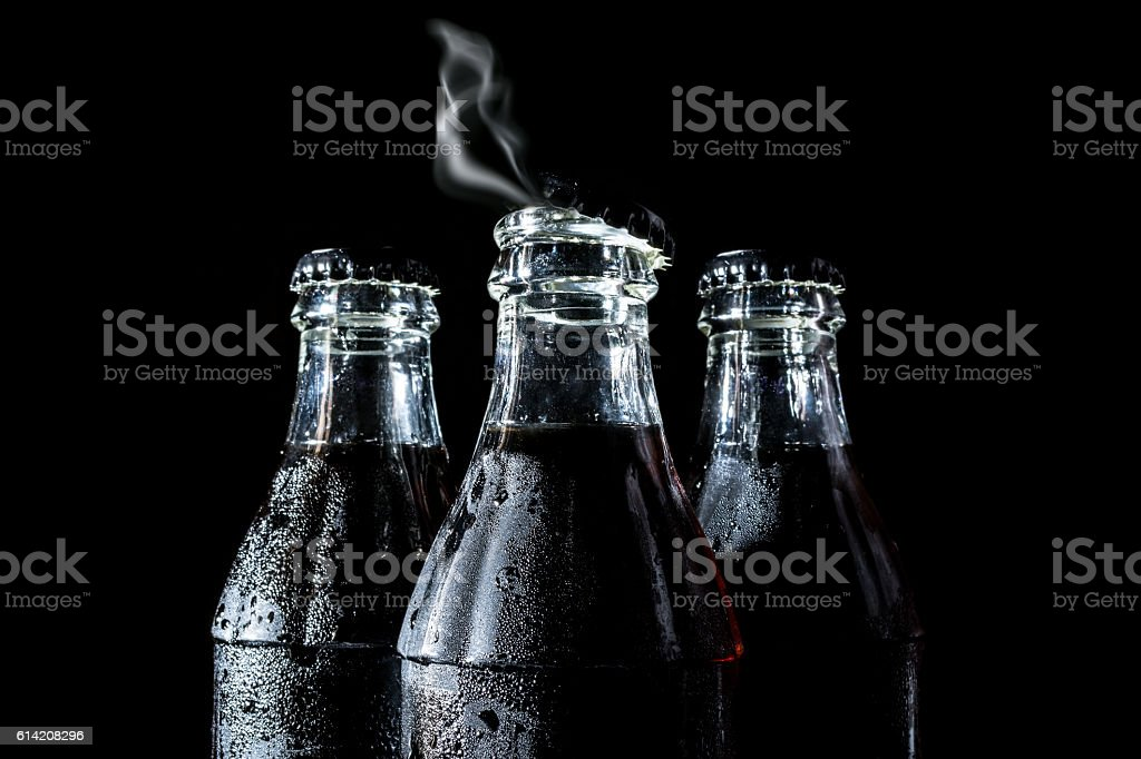 Soda glass bottles with smoke, gas, steam isolated stock photo