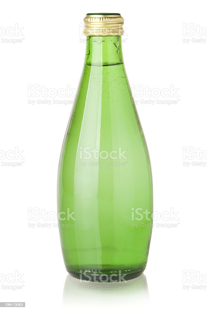 Soda water in sealed green glass bottle on white background stock photo
