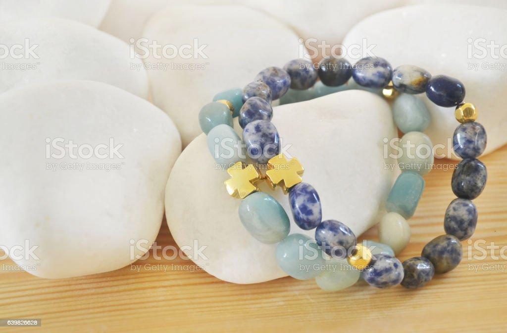 Sodalite and Amazonite gemstone bracelets with cross stock photo
