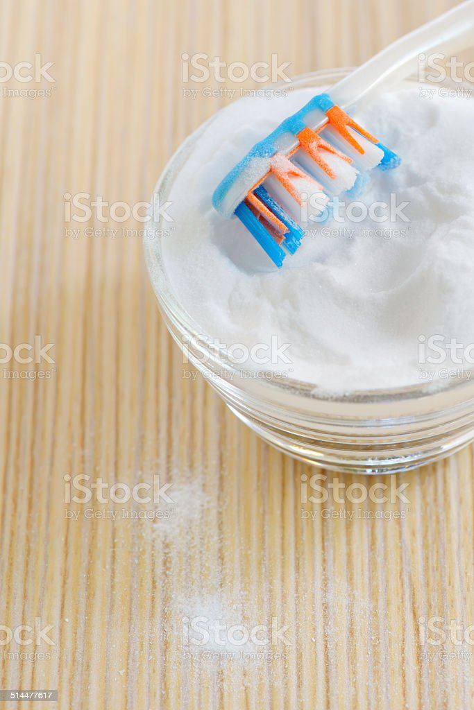 sodium bicarbonate and a toothbrush stock photo