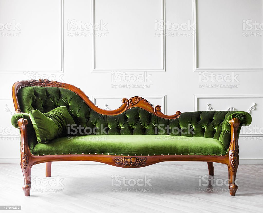 Sofa against white wall stock photo