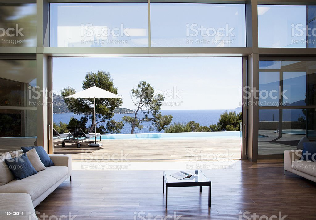 sofa and sliding doors in open modern house stock photo