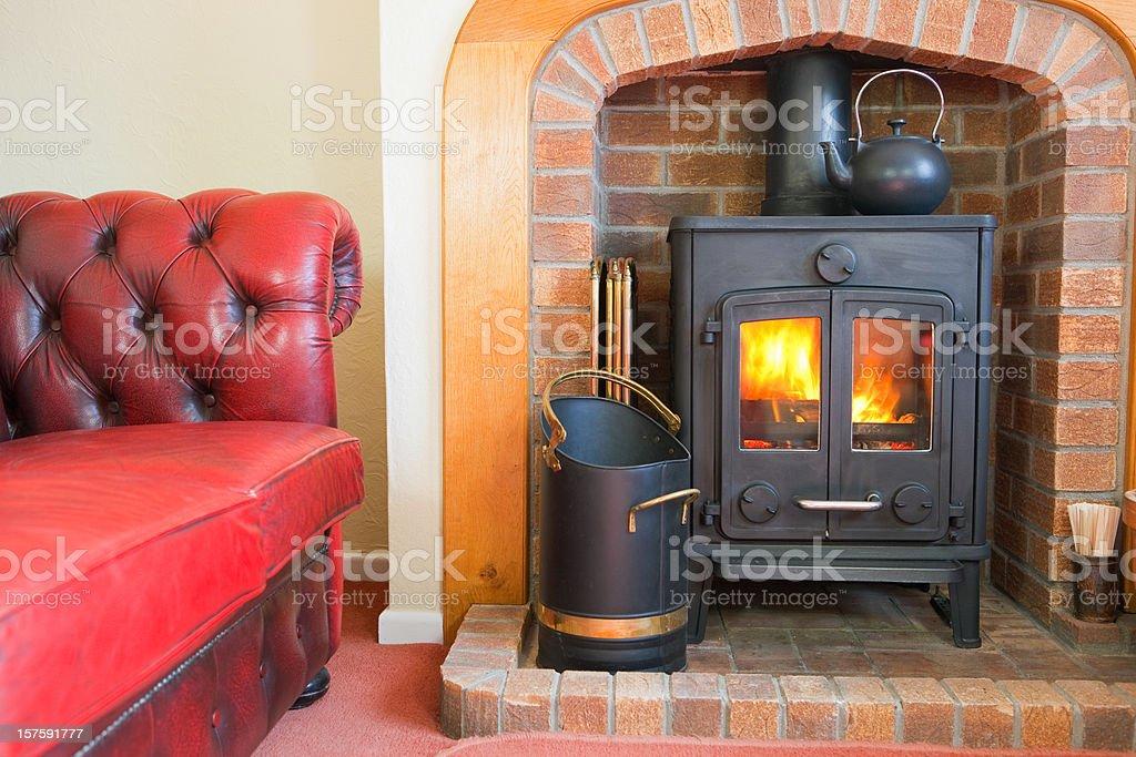 Sofa And Woodburning Stove stock photo