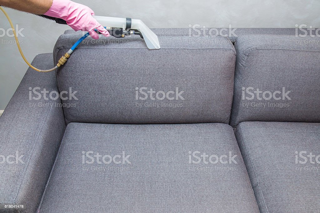 Sofa chemical cleaning with professionally extraction method. Upholstered furniture. stock photo