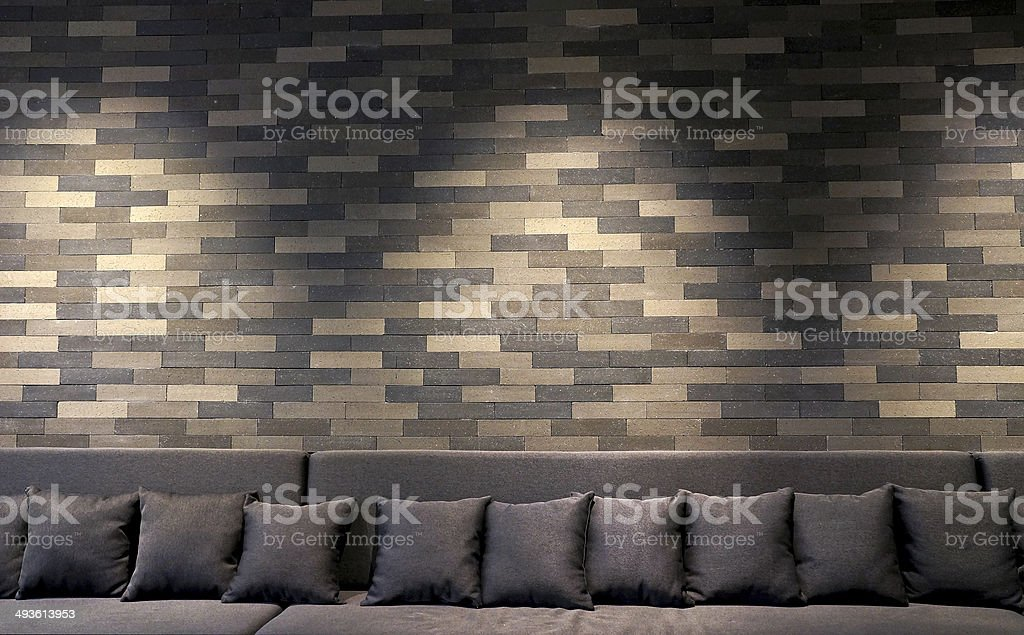 sofa in brick room and lighting on wall stock photo