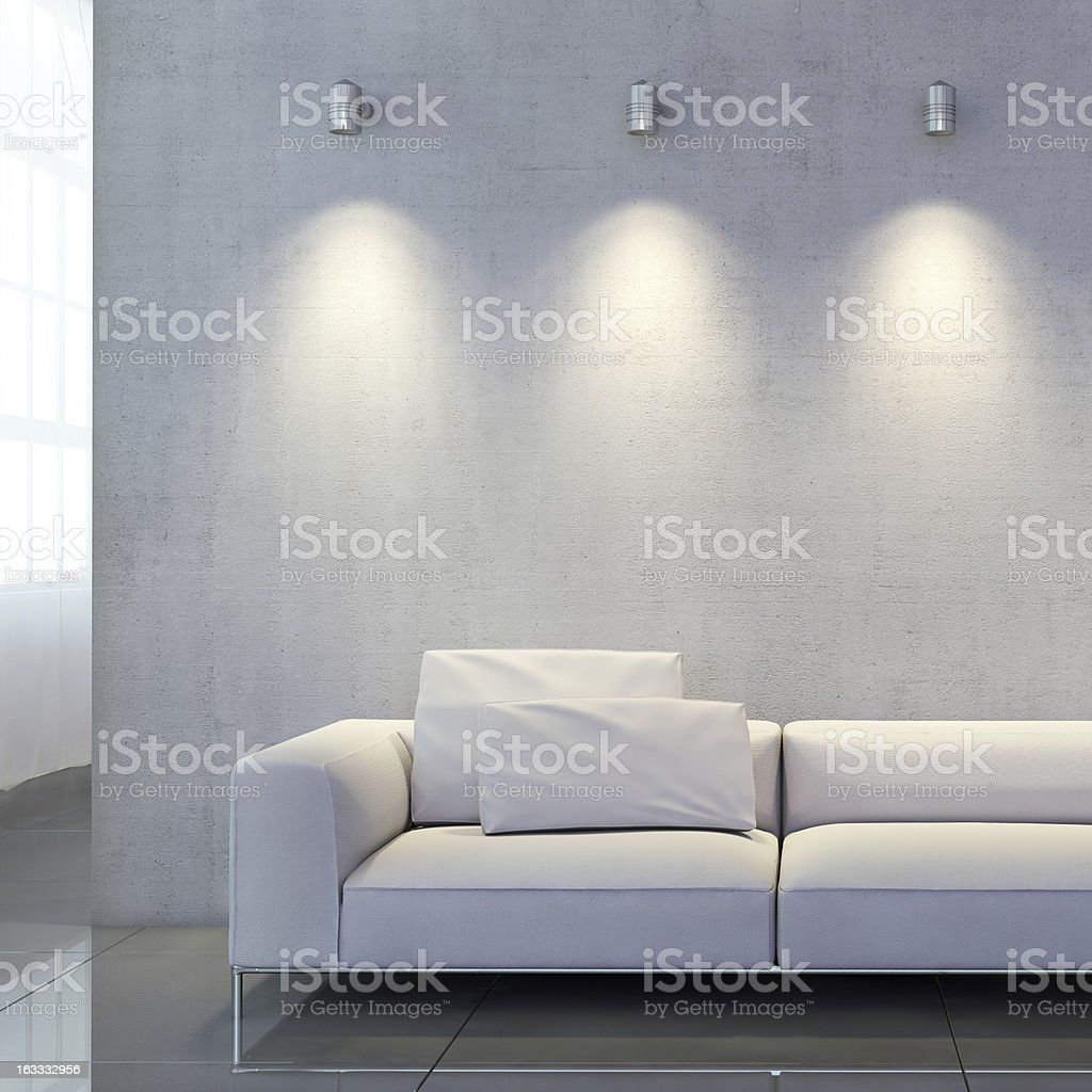 Sofa in front of well lit wall royalty-free stock photo