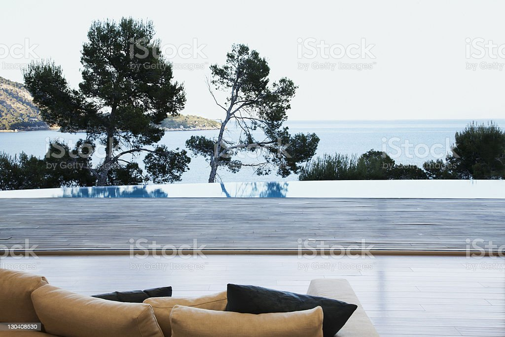 Sofa overlooking patio of modern house royalty-free stock photo